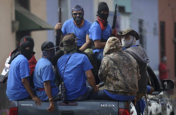 Ortega'nın maskeli 'gönüllü' polisleri